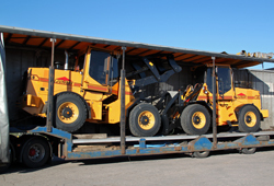 Wheel loaders loaded on truck, ready for delivery to YrkesAkademin in Sweden.